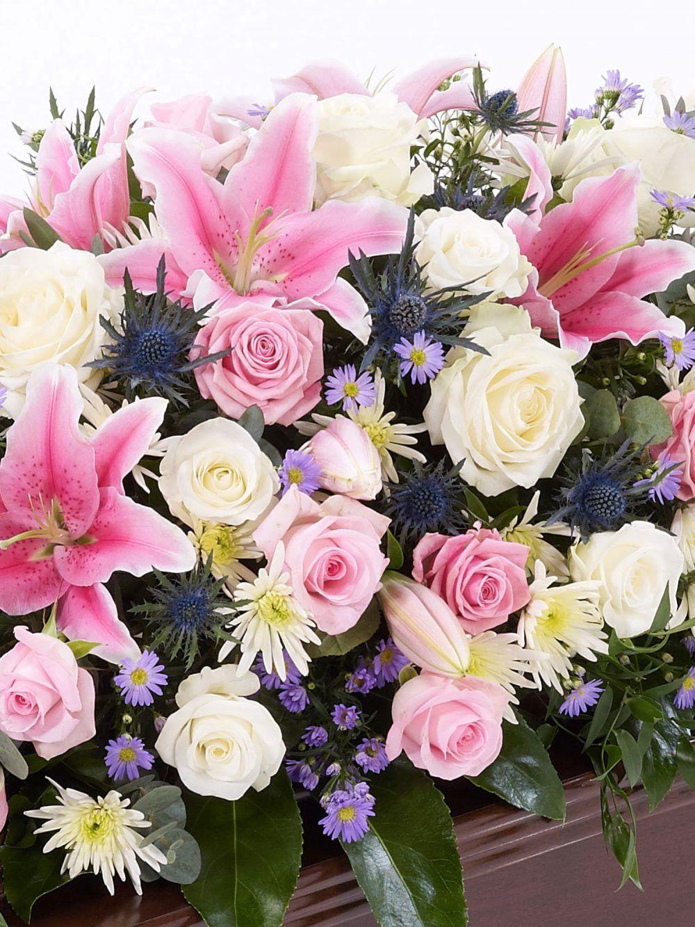 Rose And Eryngium Casket Spray 1